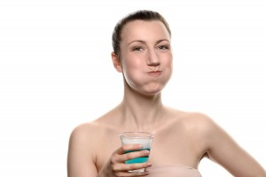 Woman Using Mouthwash During Oral Hygiene Routine